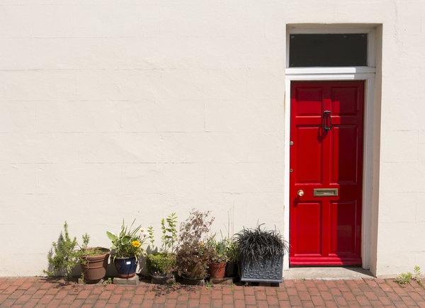 Red door: Side door to an alley in Sussex, England.