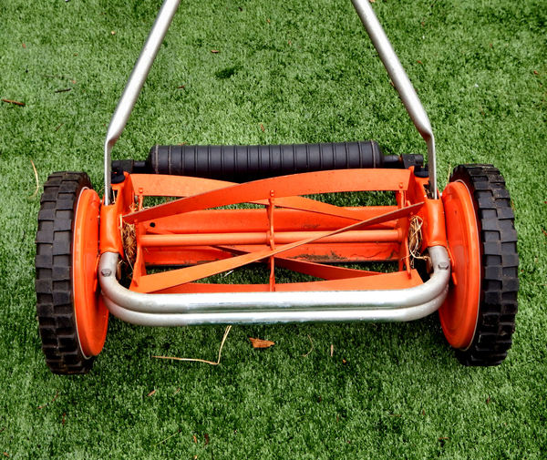 hand mower2: small lawn manual lawn mower on artificial lawn