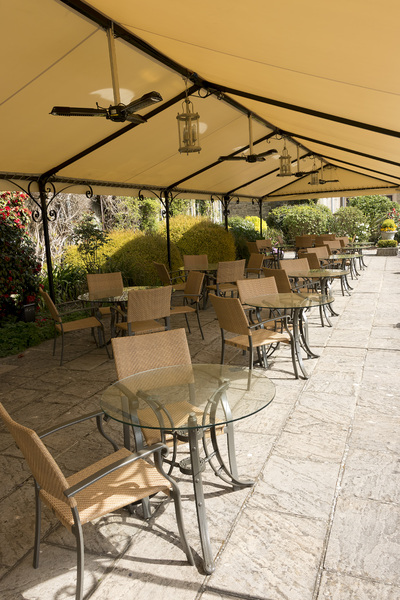 Cafe terrace: A cafe terrace in the grounds of a hotel in Sussex, England. Photography in this area was freely permitted.