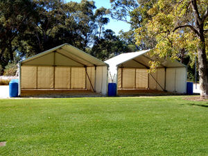 temporary tent2: erected park tent shelters in readiness for people programme