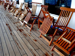 on deck2: empty deckchairs in cool and wet side of the ship