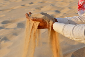 Sand in the hand of an Indian