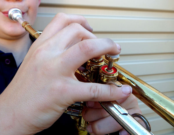 young music maker2: boy learning to play the trumpet  --  fingering