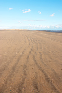 Sandy beach: The huge sandy beach at Camber Sands, East Sussex, England, photographed in evening light.