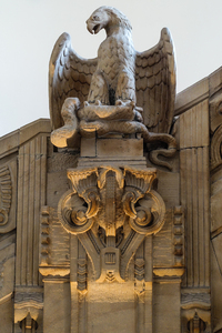 stone eagle: This stone eagle, created by H. Giesecke, is part of the stucco decoration of the main staircase in the public town hall of Berlin-Charlottenburg-Wilmersdorf. It was created 1899.