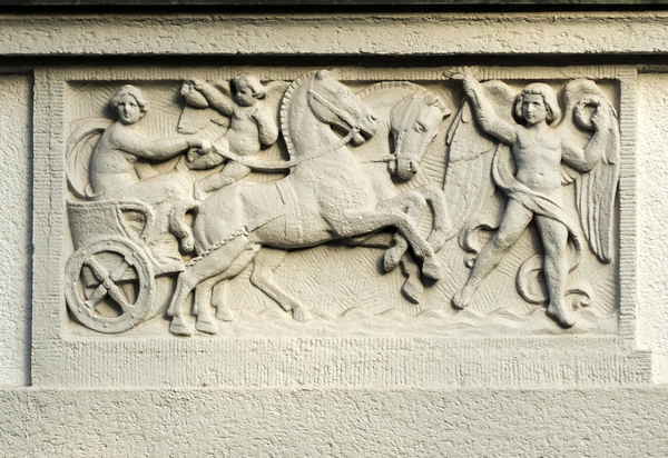 stucco horse-drawn carriage