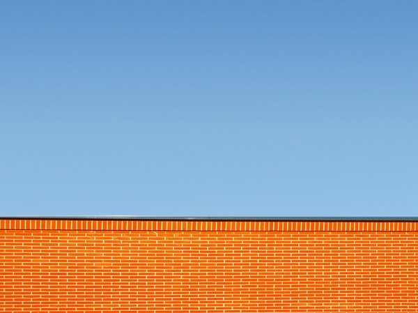 wall: wall and blue sky.High res photo  available here:http://www.stockxpert.com ..