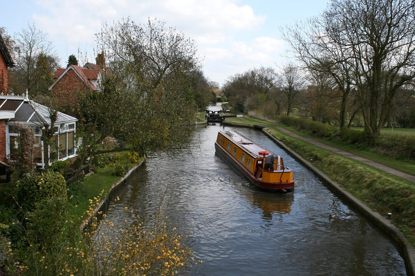 Narrowboat: A narrowboat on a canal in the Midlands of England.