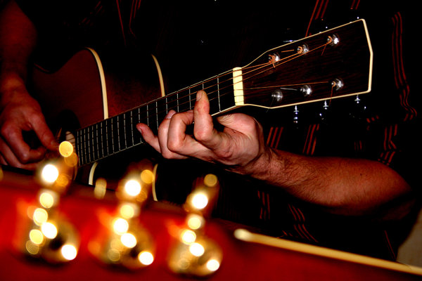 guitars: friends playing the guitar