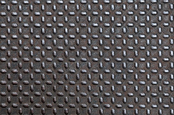 Diamond plate metal: Aged sheet of diamond plate metal on a sidewalk in Portland, Oregon.