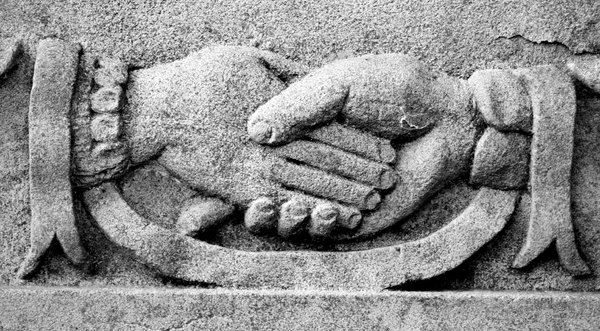 Grave Carving: A clasping hands carving from a Victorian gravestone.