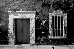 Door and window B&W: Black & white shot of an old door and window and textured wall