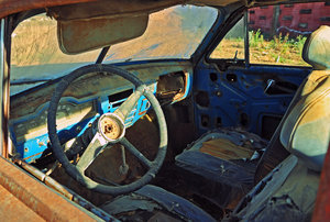Rusty car interior: Image of an old, rusty, abandoned car