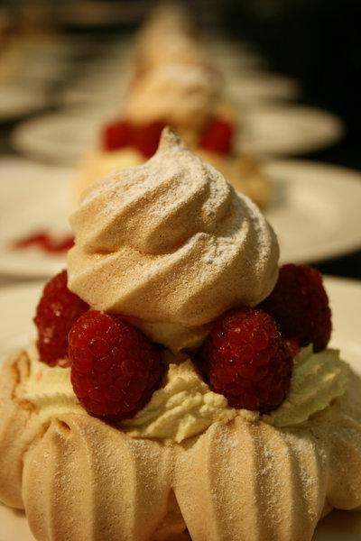 Raspberry Pavlovas: Individual Raspberry Pavlovas about to get served to a wedding  party!