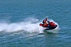 Jet Ski: Jet ski under power on a blue sea