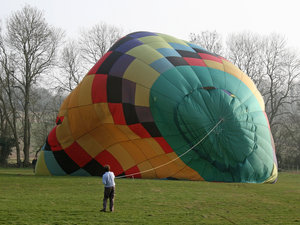 Hot Air Balloon: Inflating a hot air balloon in early evening in England in spring.