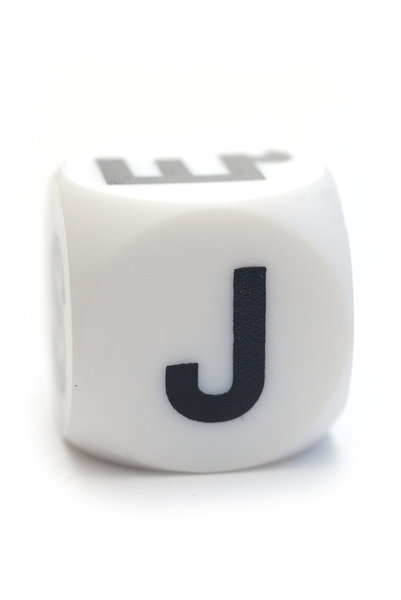 Character J on the cube: Dice with letter J