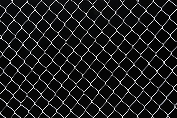 Wire netting texture 2: Netting fence on black background pattern