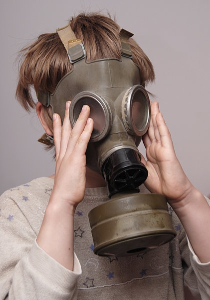 Boy in the soviet gas mask  3: Mask worn over the face to protect the wearer from inhaling airborne pollutants and toxic materials