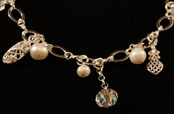 Silver bracelet with pearls an
