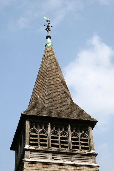 Steeple: Steeple of an old wooden rural church in West Sussex, England.