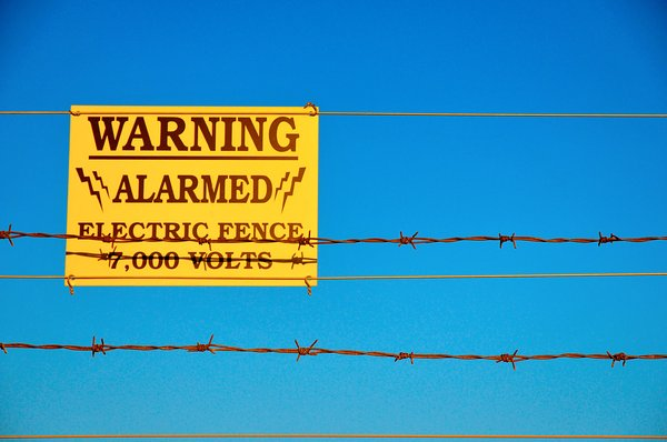 Security: Electric fence warning.