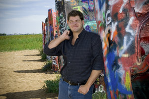 Me: Myself standing beside the famous Cadillac Ranch.  I took this photo for my mom.  I was asked to make new photos of myself and my siblings for her to put up on her living room wall.  I have really small eyes don't I?