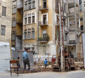 Old v new: A small plot on Spears street is being prepared for a new construction which will block out light to the old buildings around it. This photo shows immigrant Syrian workers.