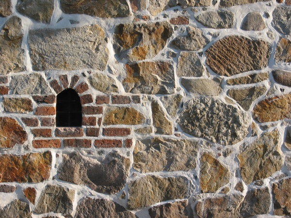 wall texture with loophole: wall from medieval building in Lund, Sweden.