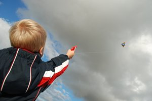 Kite Boy 3: Six years old boy flying a kite.