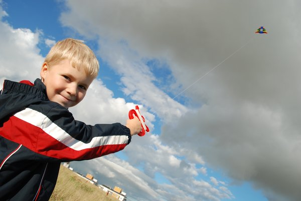 Kite Boy 1: Six years old boy flying a kite.