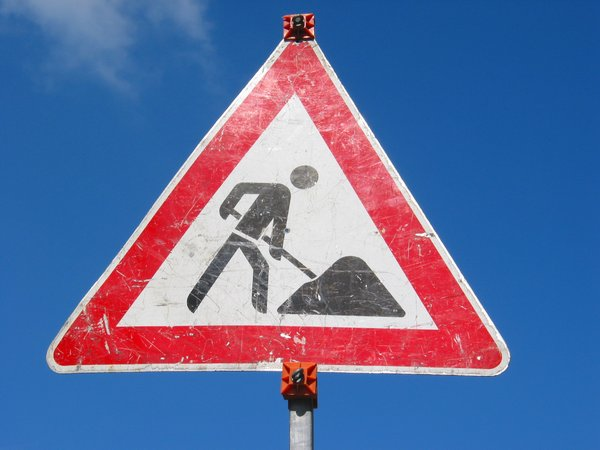 Traffic Sign: Traffic sign, warning, road work ahead. Germany.