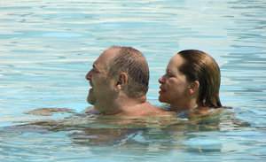 Heber y Mariu: My Pai de Santos, Heber Ureta and his wife in the pool of a local hotel.