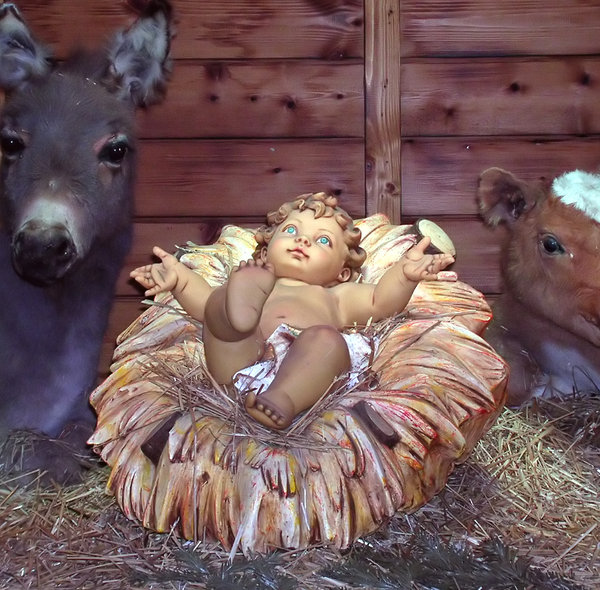 Baby in a manger 1: Scene from a life size nativity at the Luxembourg Christmas market.