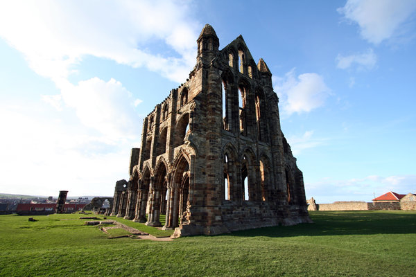 Whitby Abbey: Perched high on a cliff, the gaunt remains of this once magnificent abbey stand high above the picturesque seaside town of Whitby.
