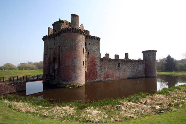 Caerlaverock Castle  2: Surrounded by a double moat and hundreds of acres of flat marshy willow woods , Caerlaverock was built to control the South-West entrance to Scotland which in early times was the waterway across the Solway Firth. Building began in about 1277, and by 1300