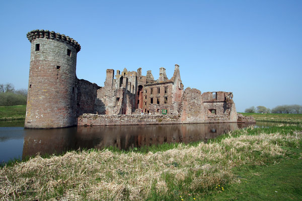 Caerlaverock Castle  4: Surrounded by a double moat and hundreds of acres of flat marshy willow woods , Caerlaverock was built to control the South-West entrance to Scotland which in early times was the waterway across the Solway Firth. Building began in about 1277, and by 1300