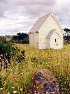Presbyterian Church: Disused country church from 1886, Kohekohe, New Zealand. This is the side of the church from the front.  Door on other side.A memorial stone has been erected in the foreground.