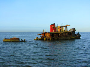Tug No More: Done with it's useful life, now used as fishing platform