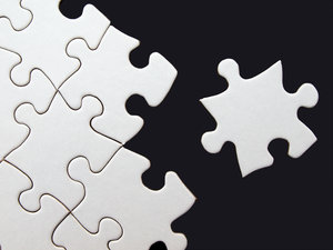 Puzzle: Blank puzzle on black sheet