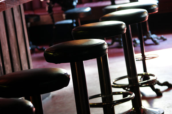 Stools.: Several stools in a pub.