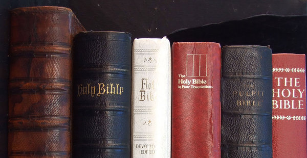 Bible collection: row variety of old and current Bible