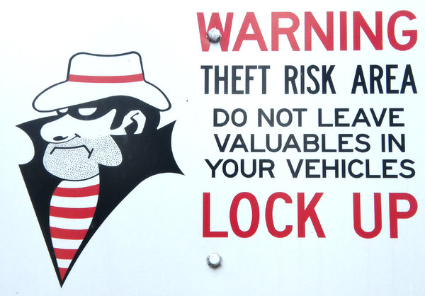 theft risk: sign warning of theft risk