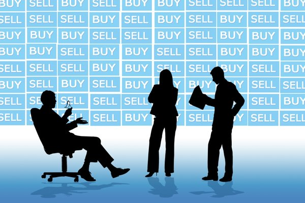 Business Market: Business team meeting against a buy and sell backdrop