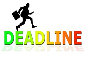Deadline: Business man running across the word Deadline