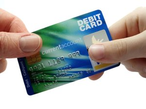 Credit Card: Creit card being passed between two hands