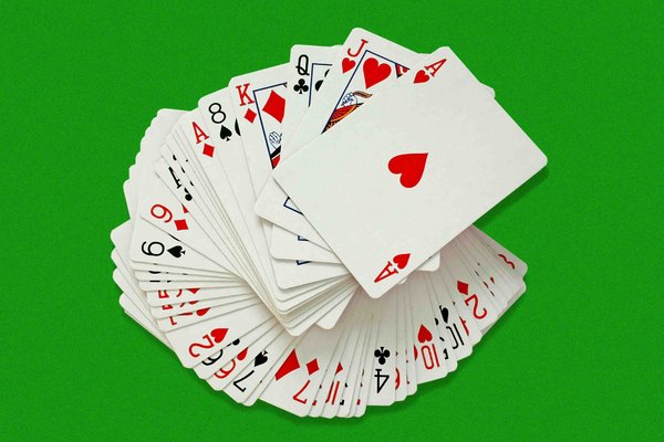 Playing Cards: A swirl of playing cards on green baize