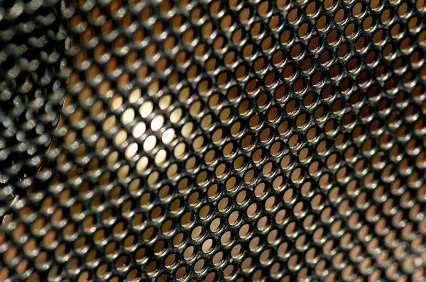 Speaker Grill: Close up of a speaker grill on a portable radio.