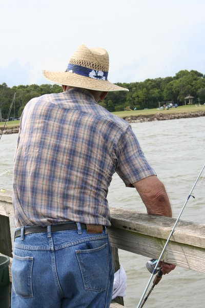 Old Man: Old man fishing on the Pine Gully dock in Seabrook, Texas