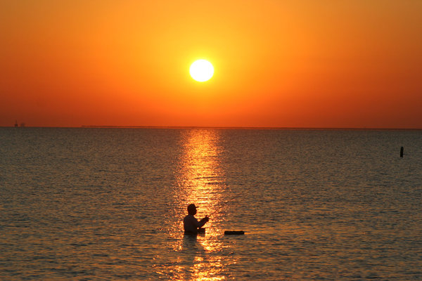 Sunrise with a Fisherman